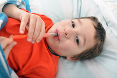 Little boy takes medicin. Little boy takes his medicine by himself Stock Photos