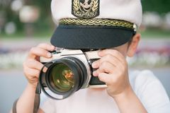 Little boy takes a picture using film camera stock photos