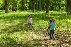 A little boy takes pictures a gir Stock Photography
