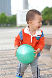 Little boy taking a ball Stock Images