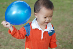 Little boy taking a balloon Stock Photos