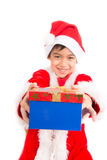 Little boy taking giving present on christmas time Royalty Free Stock Photography
