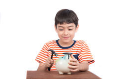 Little boy taking hammer thinking and trying to broke piggy bank Stock Images