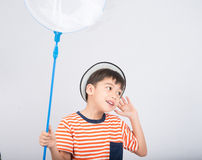 Little boy taking insect net outdoor activities on white background. Little boy taking insect net on white background stock photos