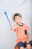 Little boy taking insect net outdoor activities on white background. Little boy taking insect net on white background royalty free stock photography