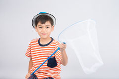Little boy taking insect net outdoor activities on white background. Little boy taking insect net on white background stock photo