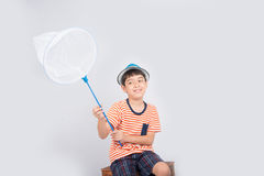 Little boy taking insect net outdoor activities on white background. Little boy taking insect net on white background royalty free stock photo