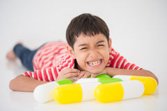 Little boy taking medicine drug Stock Photo