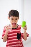 Little boy taking medicine drug Royalty Free Stock Images
