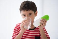 Little boy taking medicine drug Stock Photos