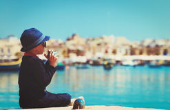 Little boy taking photos on the quay of Malta, Europe Royalty Free Stock Photography