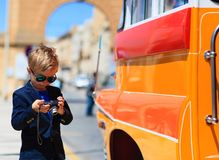 Little boy taking photos of traditional bus in. Malta, Europe Royalty Free Stock Images