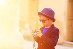 Little boy taking photos while travel in Europe Royalty Free Stock Images