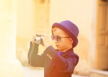 Little boy taking photos while travel in Europe Stock Images