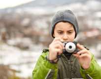 Little boy taking pictures outdoor Royalty Free Stock Image