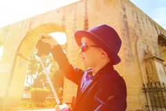 Little boy taking selfie stick picture while Royalty Free Stock Images