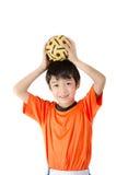 Little boy taking sepak takraw on white background Stock Images