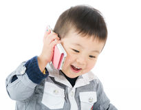 Little boy talk to mobile. Cute boy talk to phone and isolated on white Royalty Free Stock Image