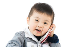 Little boy talk to phone Stock Photo