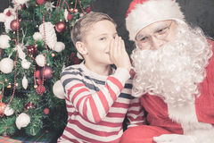 Little boy talk to Santa Claus wishlist, gifts, Christmas night Stock Images