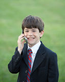 Little Boy Talking on Cell Royalty Free Stock Images