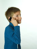 Little boy talking by cell phone. White Stock Photography