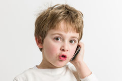 Little Boy Talking at the Mobile Stock Image