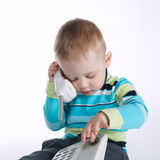 Little boy talking on the phone. Photo of little boy talking on the phone Royalty Free Stock Photo