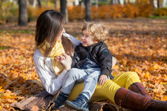 Little boy talking to his mother in nature. royalty free stock image