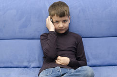 Little boy talking to a phone Royalty Free Stock Images