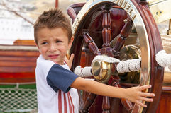 Little boy on the tall ship Stock Image