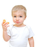 Little boy with tangerines Stock Photos