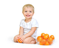 Little boy with tangerines Stock Photo