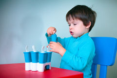 Little boy tasting homemade ice cream Stock Photos