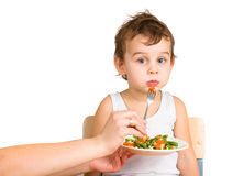 Little boy tasting salad Royalty Free Stock Photos