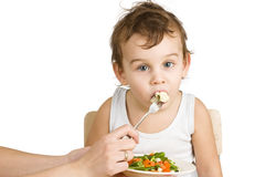 Little boy tasting salad Royalty Free Stock Image