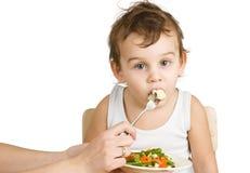 Little boy tasting salad Royalty Free Stock Image