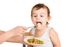 Little boy tasting vegetable salad Stock Photography