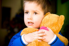 Little boy with teddy bear Royalty Free Stock Images