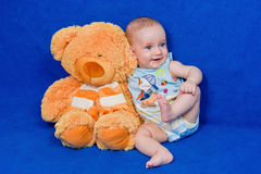 Little boy with a teddy bear Stock Photos