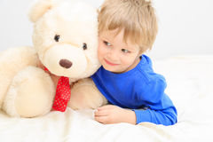 Little boy with teddy bear Stock Image