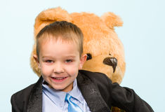 Little boy and teddy bear Royalty Free Stock Photo