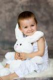 Little boy with teddy rabbit Stock Photo