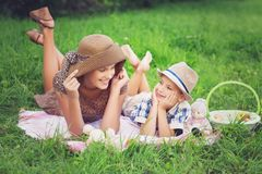 Little boy and teen age girl having picnic outdoors royalty free stock images