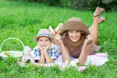 Little boy and teen age girl having picnic outdoors royalty free stock photography