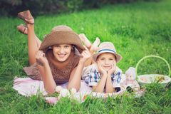 Little boy and teen age girl having picnic outdoors royalty free stock photos