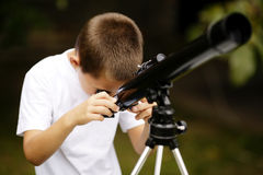 Little boy with telescope Royalty Free Stock Image