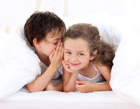 Little boy telling a secret to his sister Royalty Free Stock Image