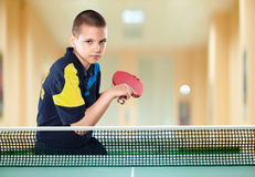 Little boy tennis-player in play. Action shot. Portrait Of Kid with Racket Playing table Tennis in Action shot stock photo