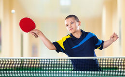 Little boy tennis-player in play. Action shot. Portrait Of Kid with Racket Playing table Tennis in Action shot Royalty Free Stock Image